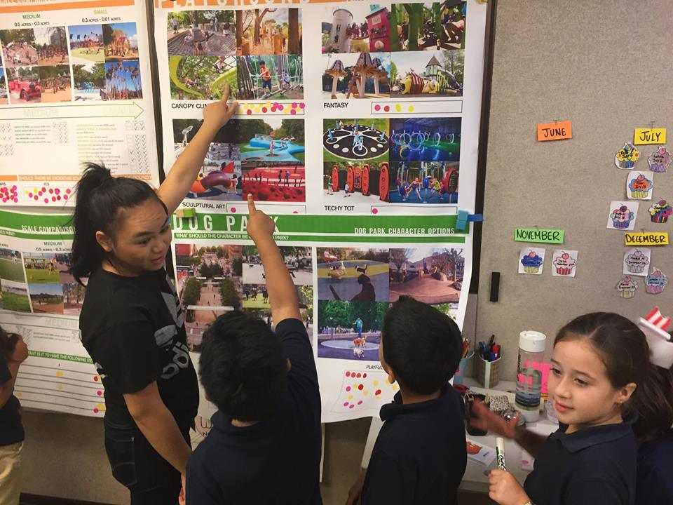 Children at Third Street Community Center play an interactive wall game