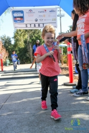 Young girl walking to raise money