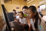 Young Asian girls get computer lessons