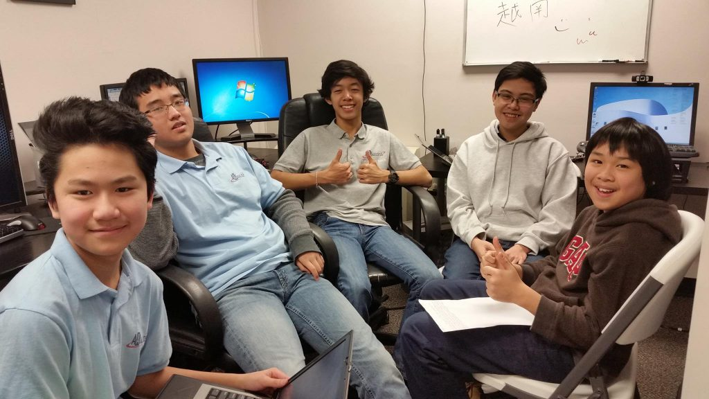 Young Asian boys take computer course
