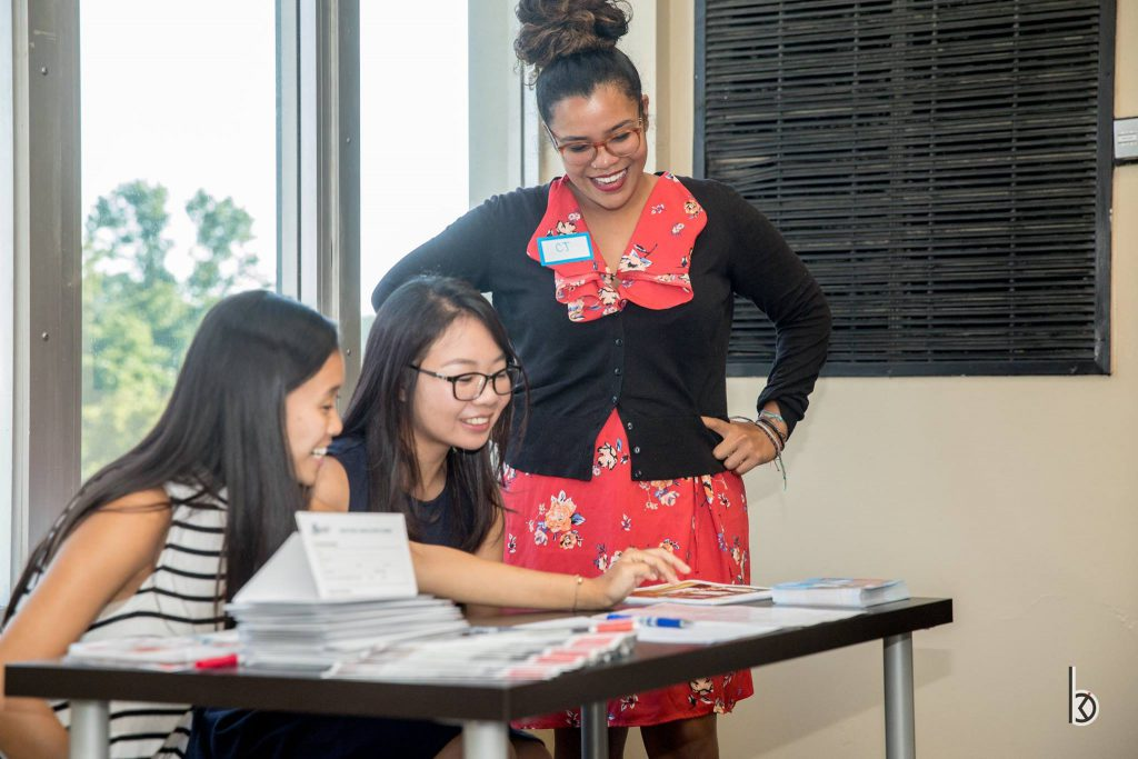 Young Asian women working with mentor