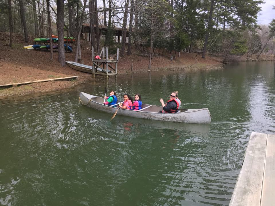 Girl Scouts canoeing
