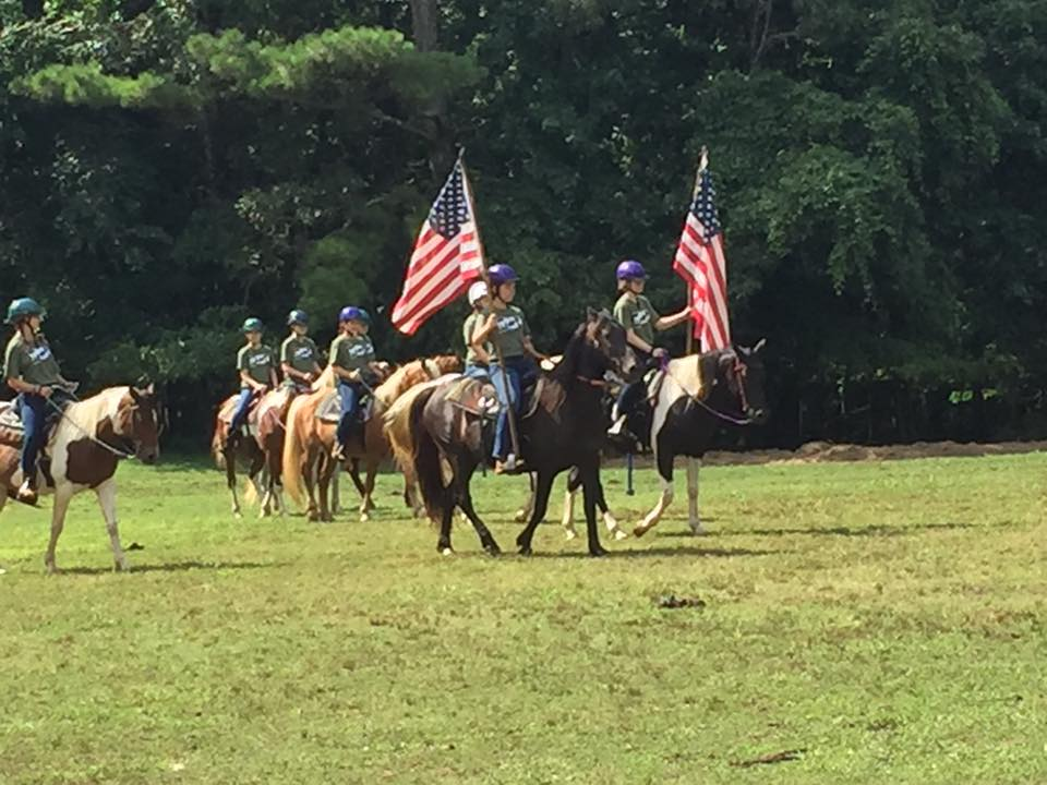 Girl Scout flag ceremony on horseback