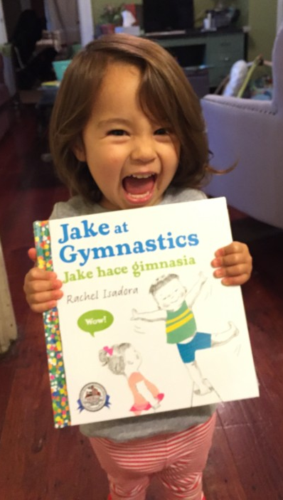 Happy child receives brand new book