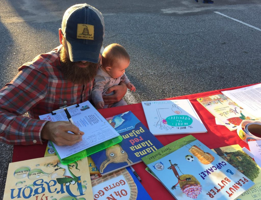 Parent signs his baby up for the BEGIN WITH BOOKS program