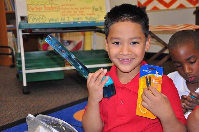 Shy boy receives school supplies
