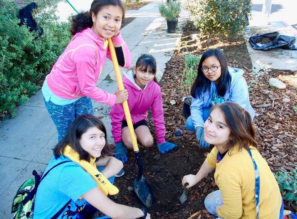Young ECS Students Dig in garden