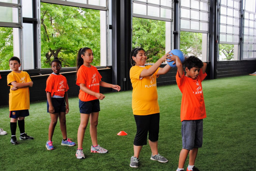 Kids successfully play a game, thanks to Playworks