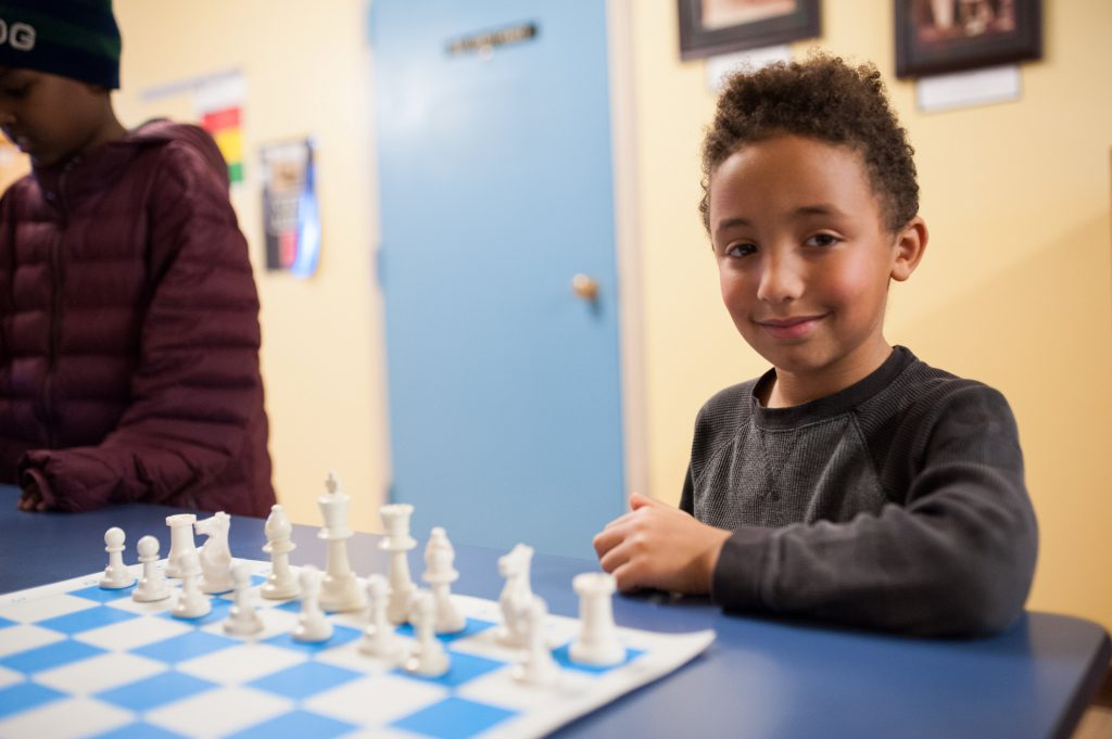 Smiling young chess player