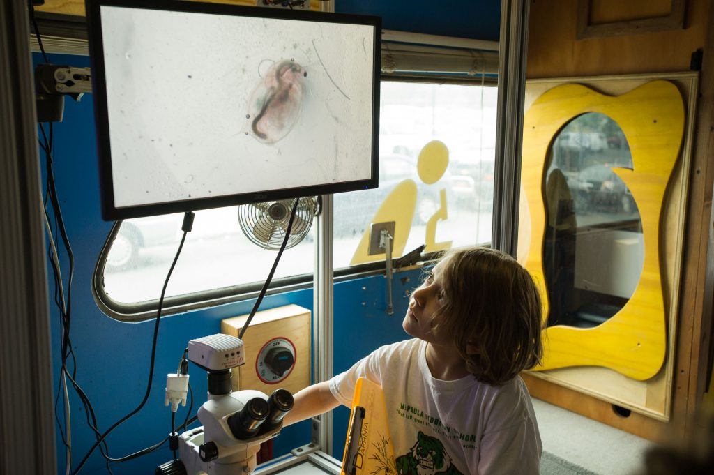 Young girl looks at screen aboard BioBus