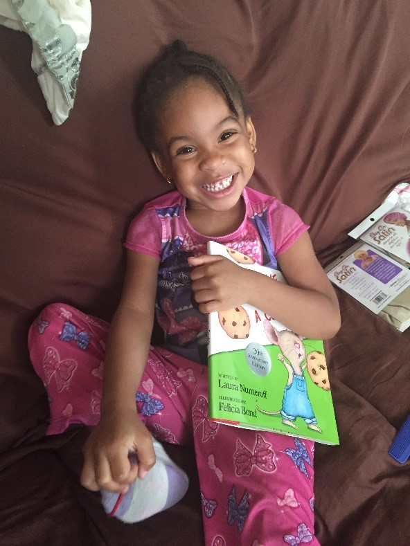 Smiling Girl with Book (Parent-Child Home Program)