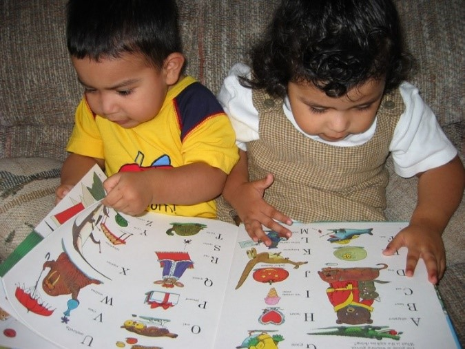 Two Children with ABC Book (Parent-Child Home Program)