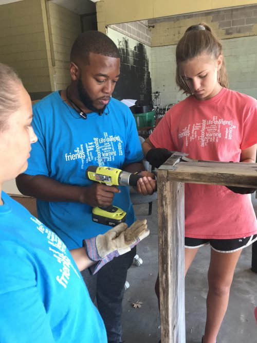 YouthServe campers working on construction project in downtown Ensley (blighted area of Birmingham) for Food Truck events with goal to foster business opportunities.