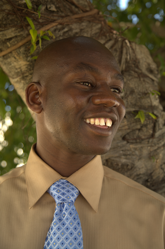 Smiling young black man in button down shirt and tie