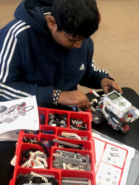 Young man learns about robotics at Elite Learners Inc