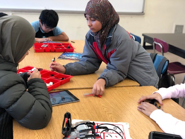 Young girls learn robotics at Elite Learners, Inc.