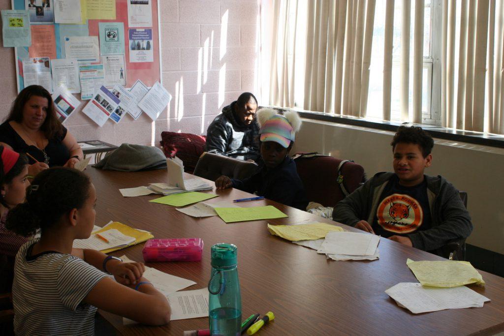 Working on debate points. Baltimore Urban Debate League (BUDL)