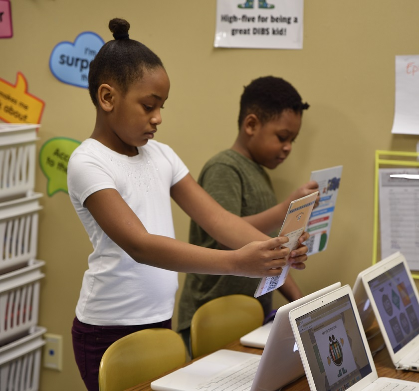 Dibs for Kids participants choosing books to take home from school