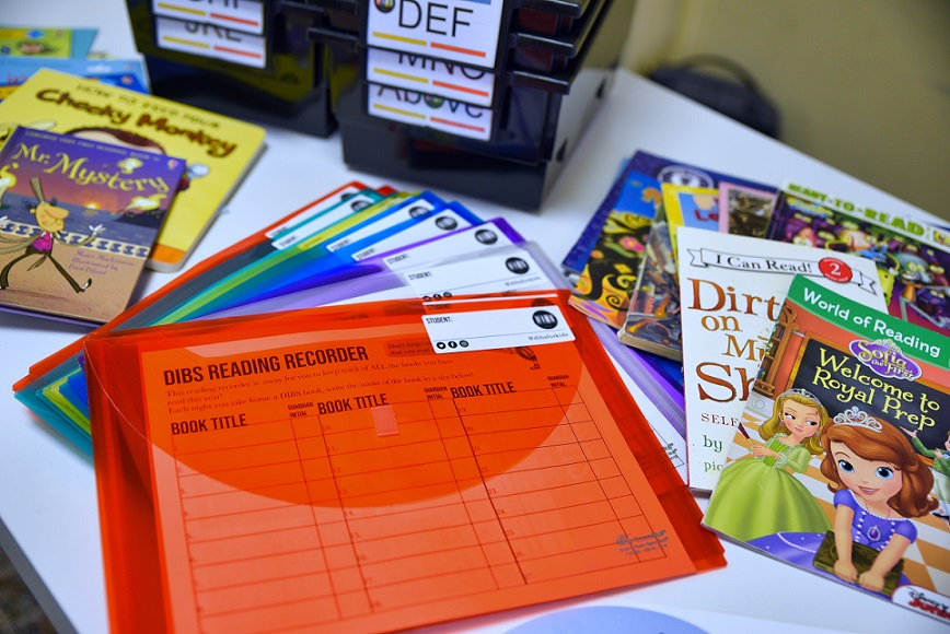 Books and items connected to the Dibs for Kids classroom book lending program