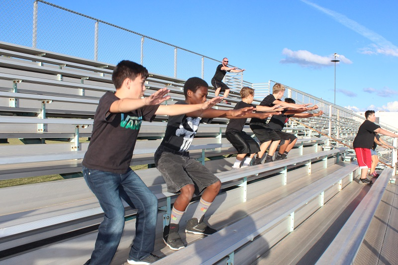 M.E.S.A. Program bleacher squats