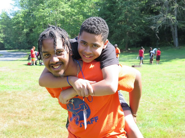 LEAP youngster on shoulder of neighborhood role model and counselor