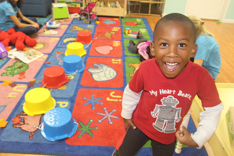 Child having fun at a Playtime Project playroom