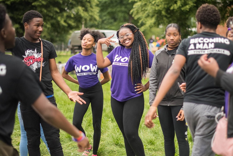 Happy Youth Guidance participants in WOW and BAM t-shirts