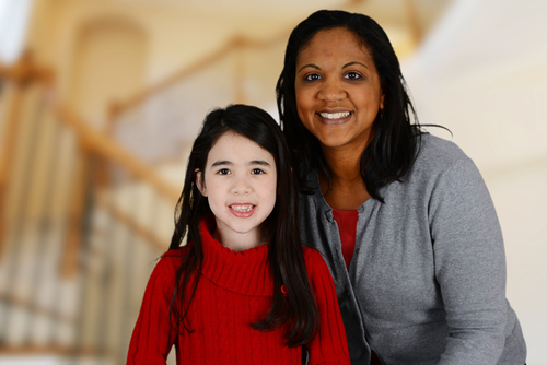 smiling volunteer guardian ad litem with young girl