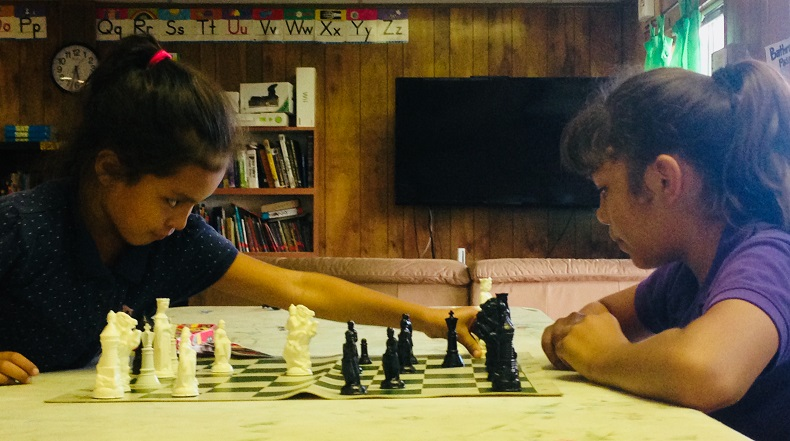 EOBA kids play chess