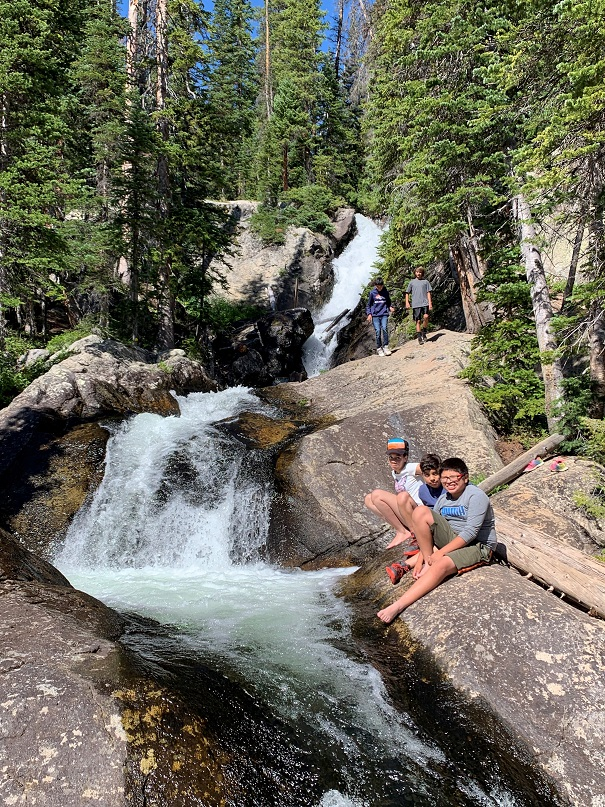 Mile High 360 students enjoy an outing to a waterfall
