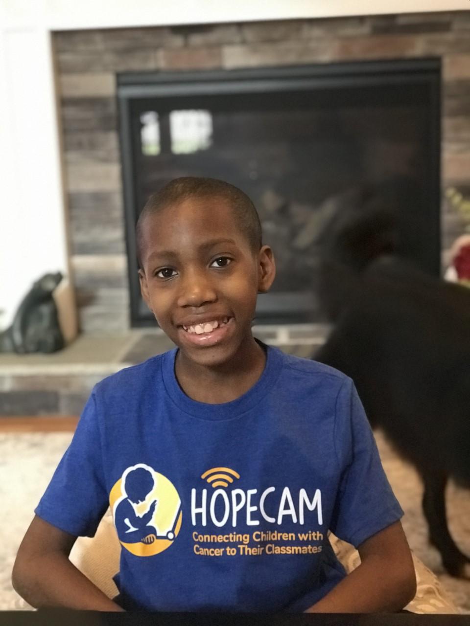 Smiling boy in Hopecam shirt
