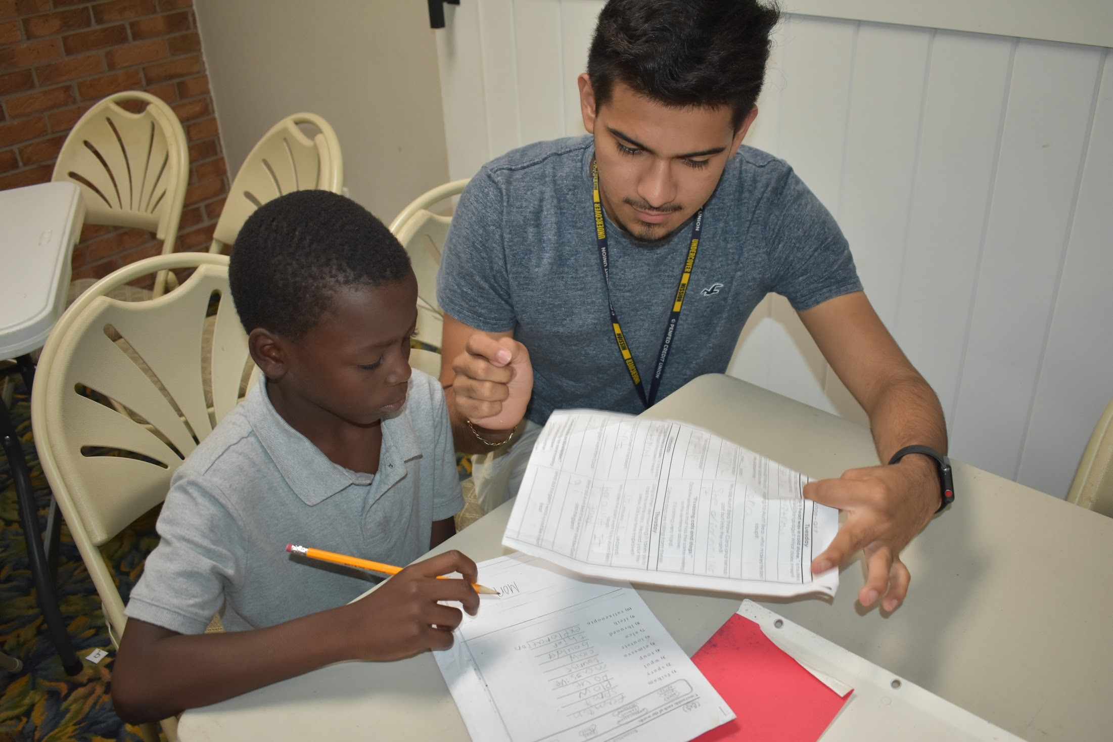 A First Serve Pal mentor works with mentee on homework