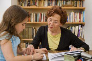 Elderly volunteer reads with child