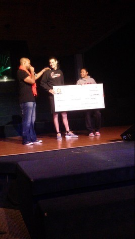 Presenting a scholarship check to a deserving student