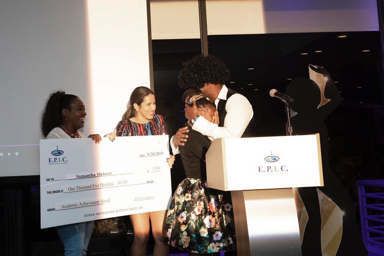 student cries on receiving a scholarship check from AJ Donaldson of the EPIC Foundation