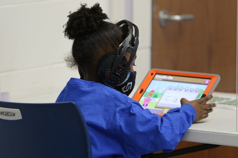 A student uses Mighty Doodle to learn to read, write, and spell