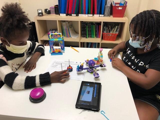 Girls build robots at Urban Scholars Academy Homework Club