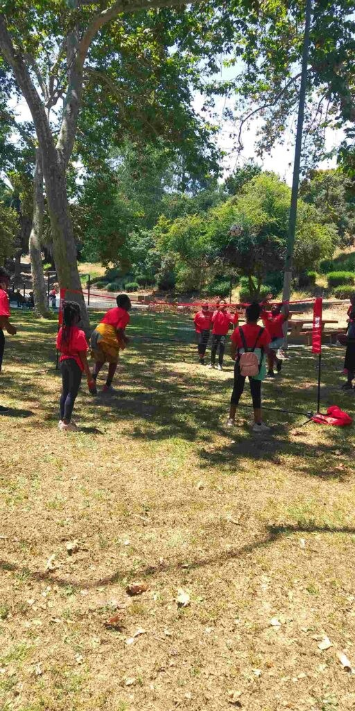 Urban Scholars Academy students play limbo in the park