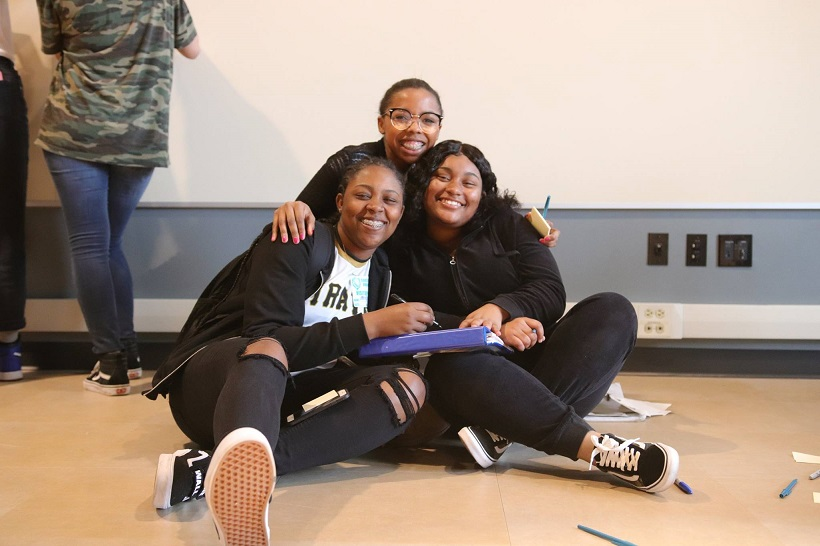 Happy trio of Youth Enrichment Services (YES) youth