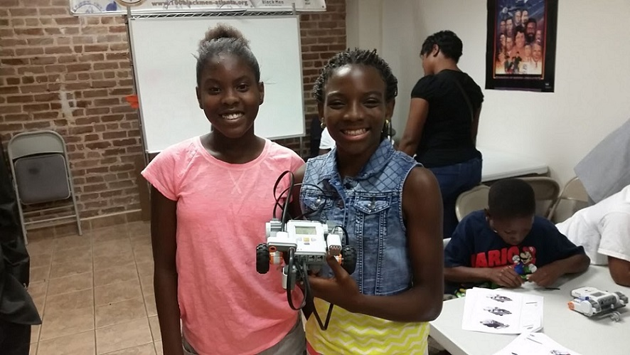 STEAMsport supports females in STEAM. These two students show their pride in building their first robot 6_15