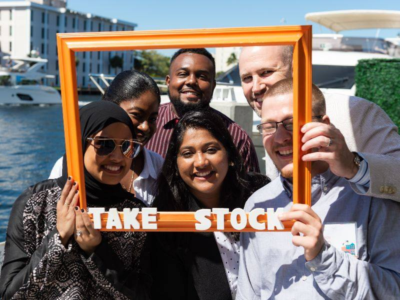 Take Stock in Broward participants and staff pose for a photo at an event