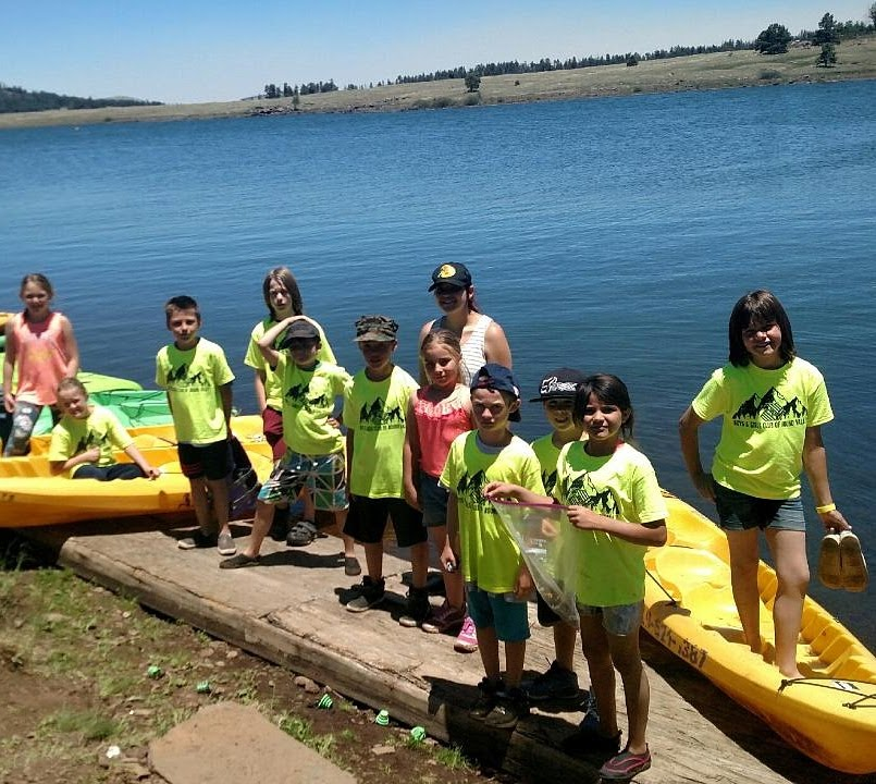 Young Arizona Outdoor Adventures participants getting ready for a group canoeing expedition