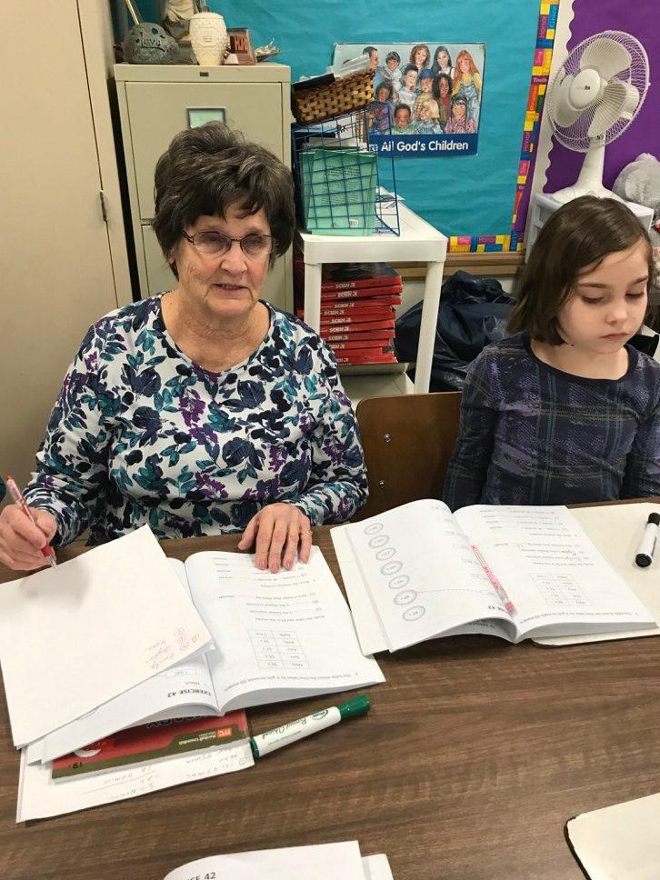 Jane Kauffman tutors a young girl via the Life Tools Foundation