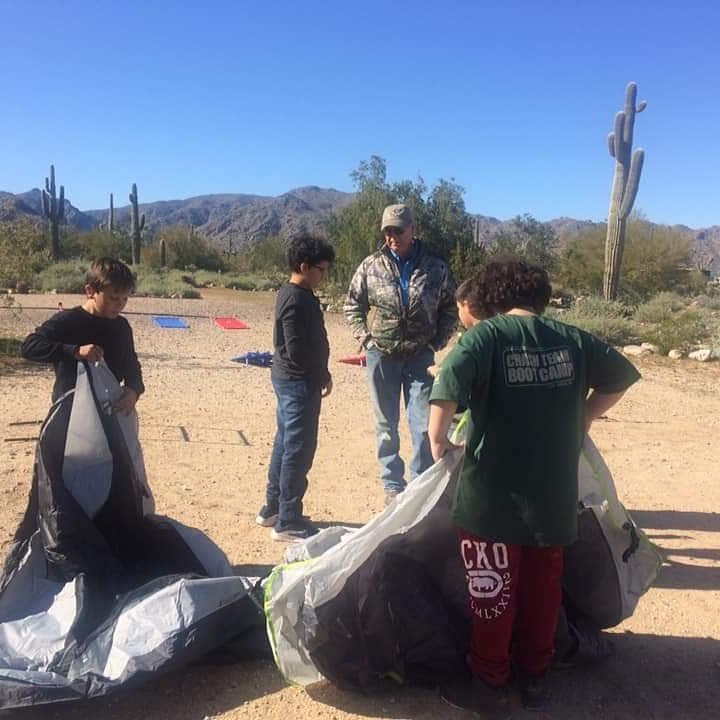 Setting up tents in the desert