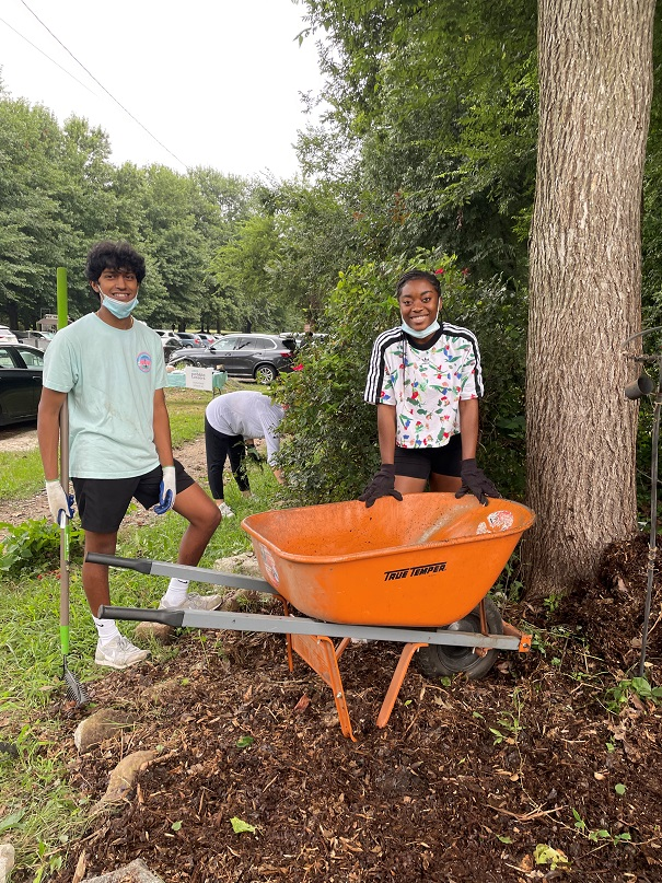 Pebble Tossers engage in some community beautification, A/K/A weeding public spaces.