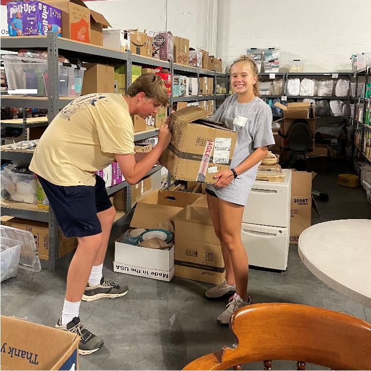 Pebble Tossers participants unloading service supplies