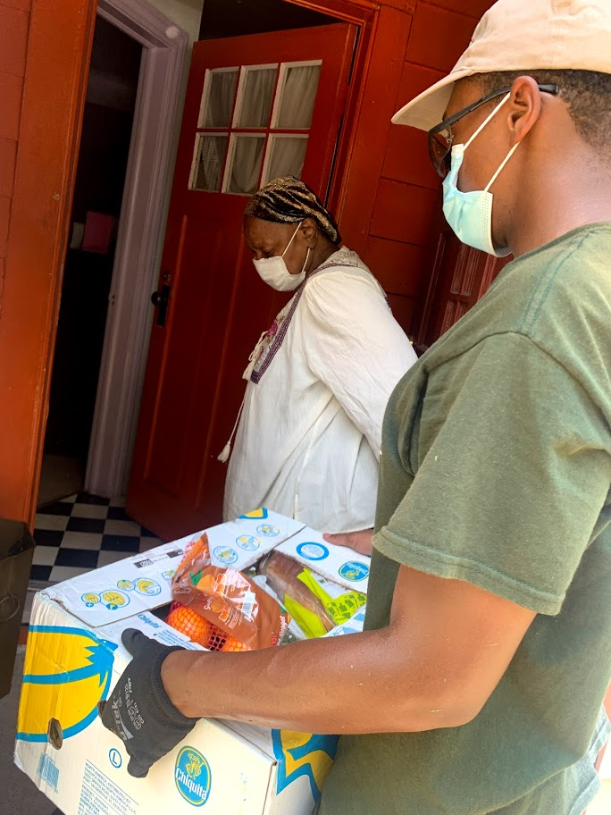 The Lawn Academy delivering food to needy seniors