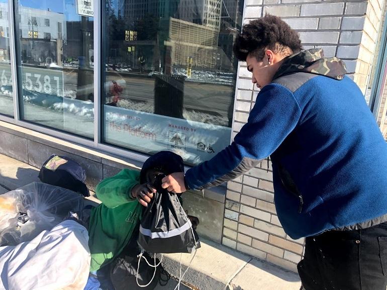 Distributing warm clothing